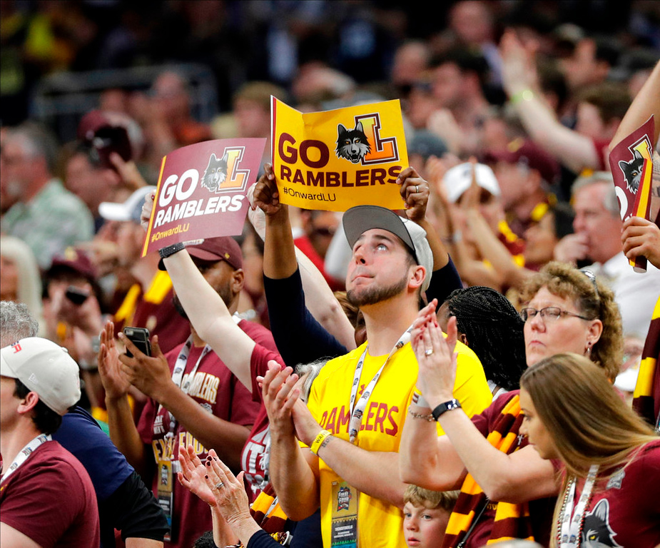 . Loyola-Chicago fans cheer during the second half in the semifinals of the Final Four NCAA college basketball tournament against Michigan, Saturday, March 31, 2018, in San Antonio. (AP Photo/David J. Phillip)