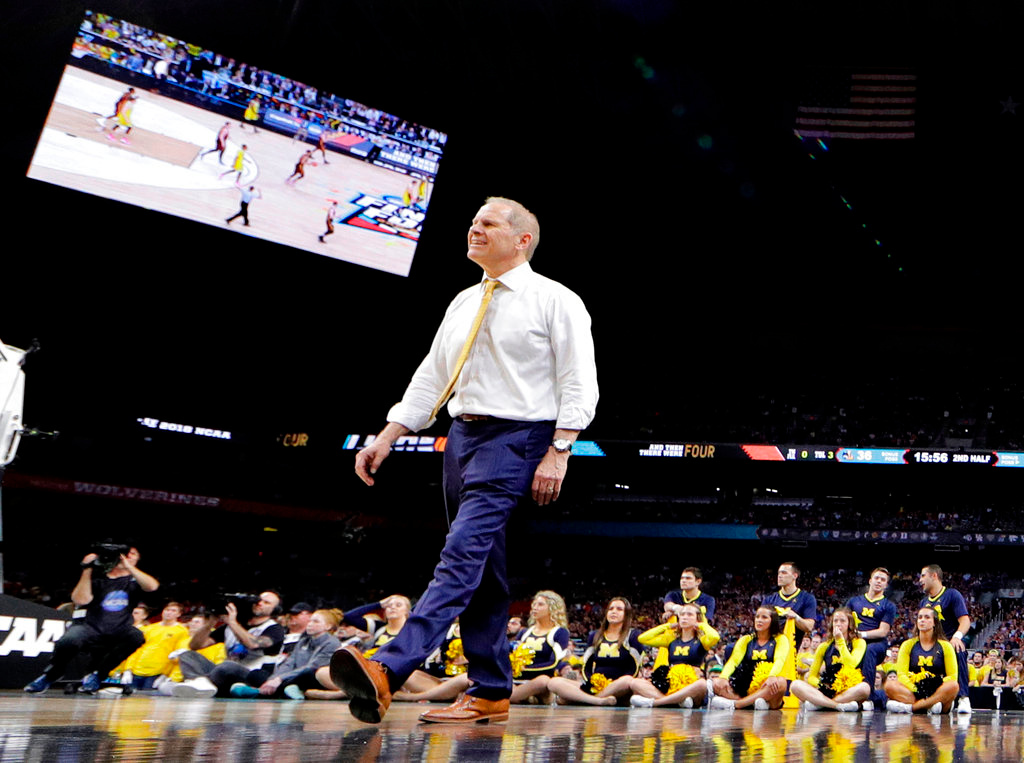 . Michigan head coach John Beilein walks on the court during the second half against Loyola-Chicago in the semifinals of the Final Four NCAA college basketball tournament, Saturday, March 31, 2018, in San Antonio. (AP Photo/David J. Phillip)