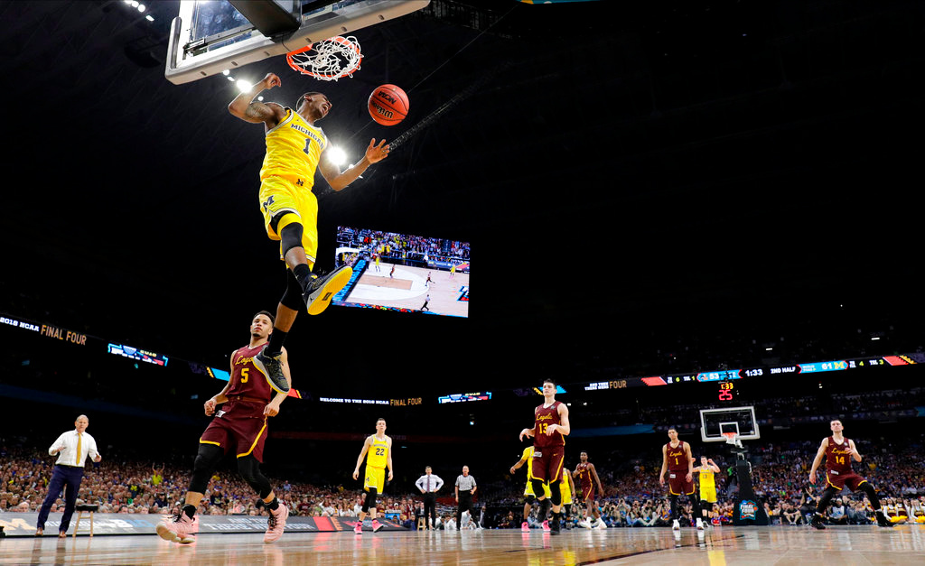 . Michigan\'s Charles Matthews (1) dunks during the second half in the semifinals of the Final Four NCAA college basketball tournament against Loyola-Chicago, Saturday, March 31, 2018, in San Antonio. (AP Photo/David J. Phillip)