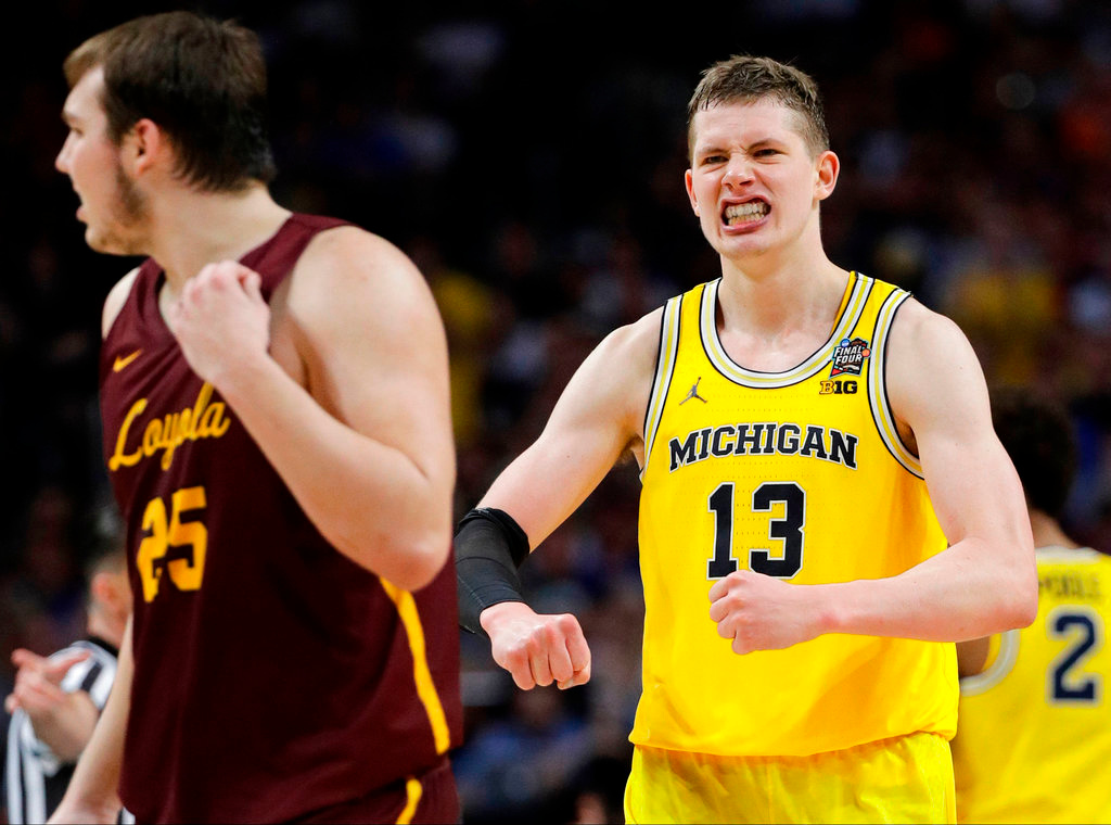 . Michigan\'s Moritz Wagner (13) reacts during the second half in the semifinals of the Final Four NCAA college basketball tournament against Loyola-Chicago, Saturday, March 31, 2018, in San Antonio. (AP Photo/David J. Phillip)