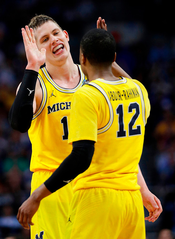 . Michigan\'s Moritz Wagner celebrates with Muhammad-Ali Abdur-Rahkman (12) during the second half in the semifinals of the Final Four NCAA college basketball tournament against Loyola-Chicago, Saturday, March 31, 2018, in San Antonio. (AP Photo/David J. Phillip)
