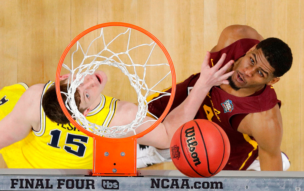 . Michigan\'s Jon Teske (15) and Michigan\'s C.J. Baird (24) watches a shot under the basket during the second half in the semifinals of the Final Four NCAA college basketball tournament, Saturday, March 31, 2018, in San Antonio. (AP Photo/Eric Gay)