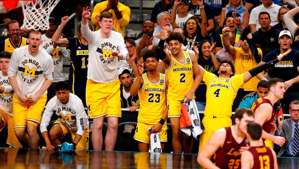 . Michigan players on the bench react during the first half in the semifinals of the Final Four NCAA college basketball tournament against Loyola-Chicago , Saturday, March 31, 2018, in San Antonio. (AP Photo/Brynn Anderson)