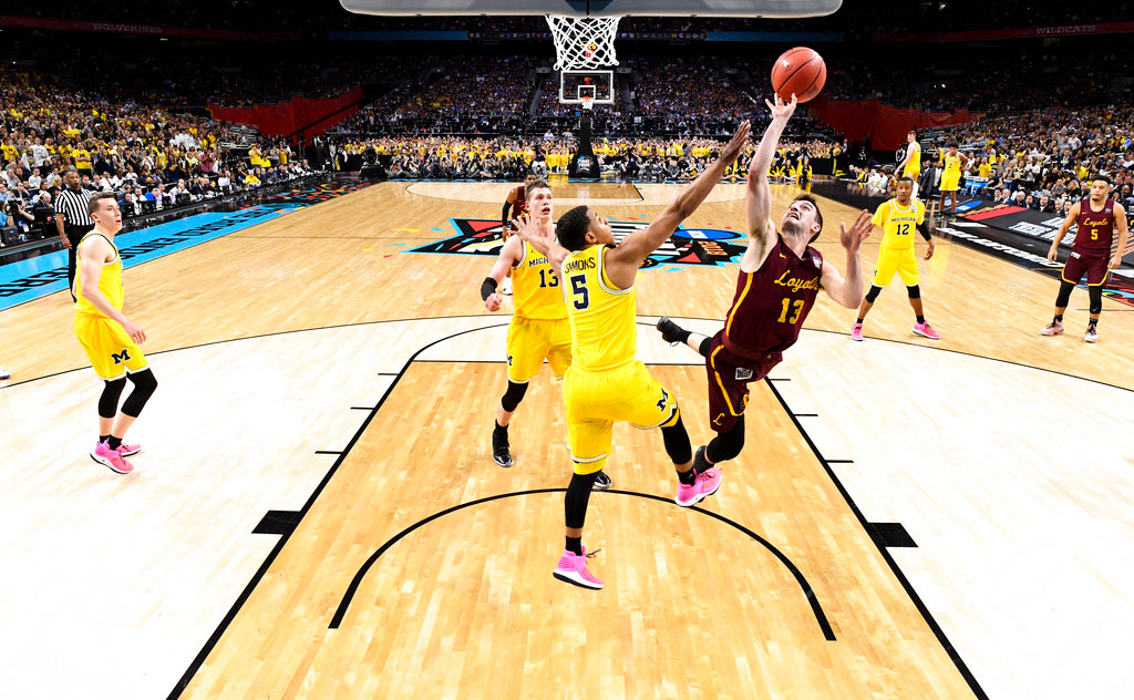 . Loyola-Chicago guard Clayton Custer (13) shoots over Michigan guard Jaaron Simmons (5) during the second half in the semifinals of the Final Four NCAA college basketball tournament, Saturday, March 31, 2018, in San Antonio. Michigan won 69-57. (AP Photo/Chris Steppig, NCAA Photos Pool)