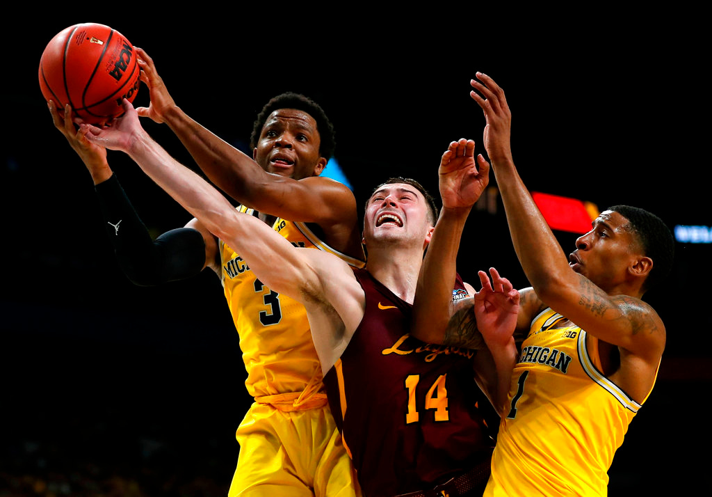 . Loyola-Chicago guard Ben Richardson (14) fights for a rebound with Michigan guard Zavier Simpson, left, and Charles Matthews, right, during the second half in the semifinals of the Final Four NCAA college basketball tournament, Saturday, March 31, 2018, in San Antonio. Michigan won 69-57. (AP Photo/Charlie Neibergall)