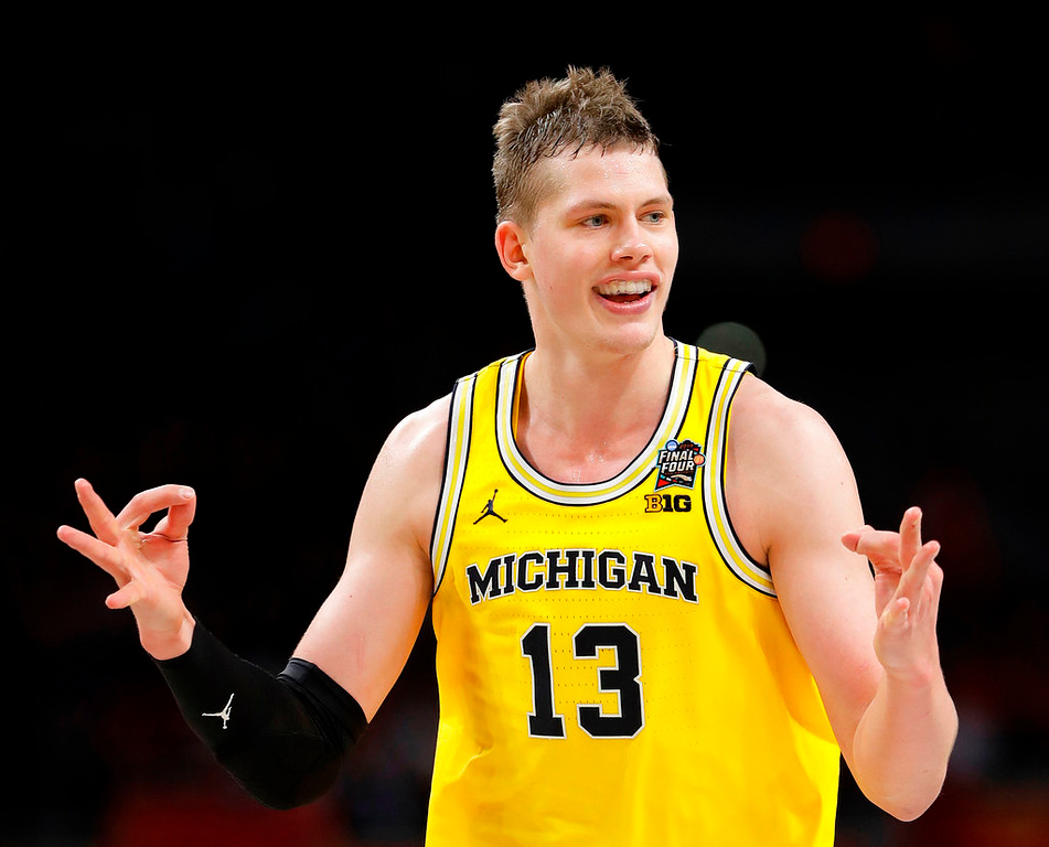 . Michigan\'s Moritz Wagner (13) celebrates during the second half in the semifinals of the Final Four NCAA college basketball tournament against Loyola-Chicago, Saturday, March 31, 2018, in San Antonio. (AP Photo/Eric Gay)