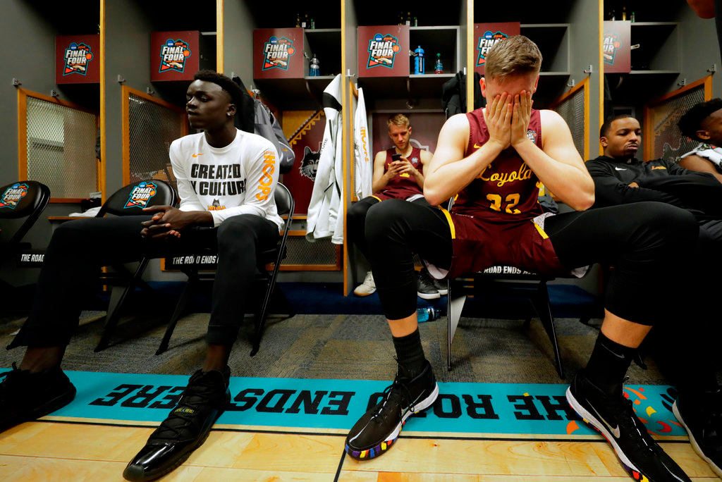 . Loyola-Chicago\'s Carson Shanks (32) cries as the rest of the team react in the locker room after the semifinal game against Michigan in the Final Four NCAA college basketball tournament, Saturday, March 31, 2018, in San Antonio. Michigan won 69-57. (AP Photo/Eric Gay)