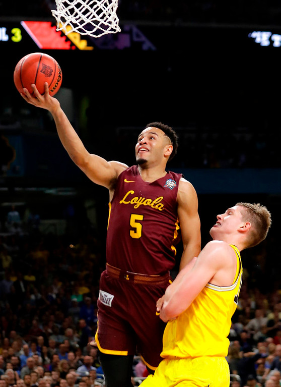 . Loyola-Chicago\'s Marques Townes (5) shoots over Michigan\'s Moritz Wagner during the second half in the semifinals of the Final Four NCAA college basketball tournament, Saturday, March 31, 2018, in San Antonio. (AP Photo/Eric Gay)