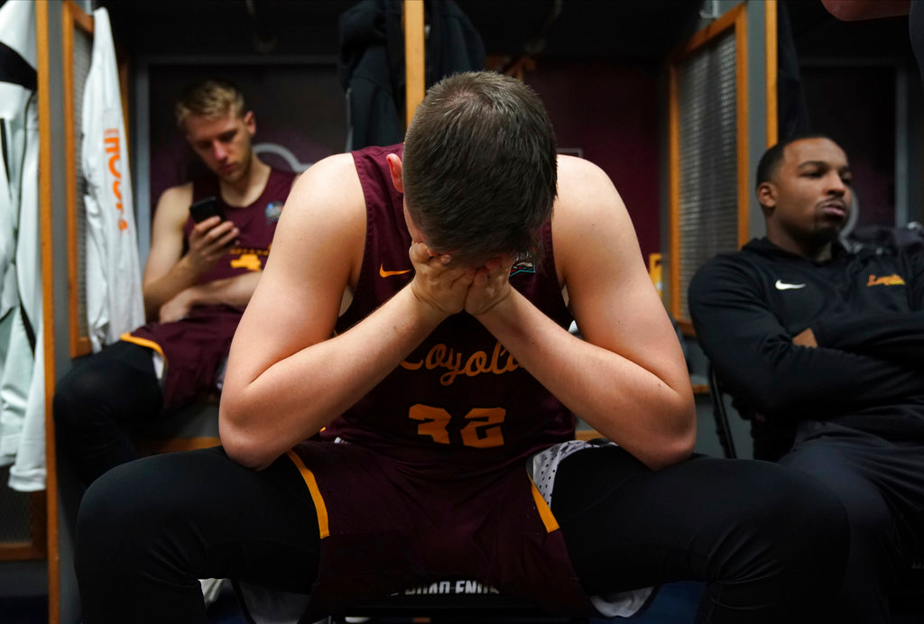 . Loyola-Chicago\'s Carson Shanks (32) cries in the locker room after the semifinal game against Michigan in the Final Four NCAA college basketball tournament, Saturday, March 31, 2018, in San Antonio. Michigan won 69-57. (AP Photo/Eric Gay)