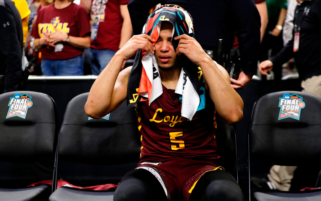 . Loyola-Chicago guard Marques Townes sits on the bench during the second half against Michigan in the semifinals of the Final Four NCAA college basketball tournament, Saturday, March 31, 2018, in San Antonio. (AP Photo/Eric Gay)