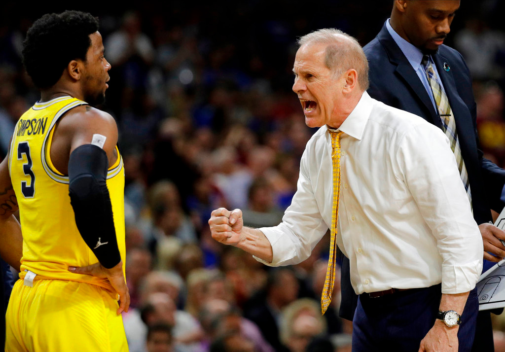 . Michigan head coach John Beilein talks to Zavier Simpson (3) during the second half in the semifinals of the Final Four NCAA college basketball tournament against Loyola-Chicago, Saturday, March 31, 2018, in San Antonio. (AP Photo/David J. Phillip)