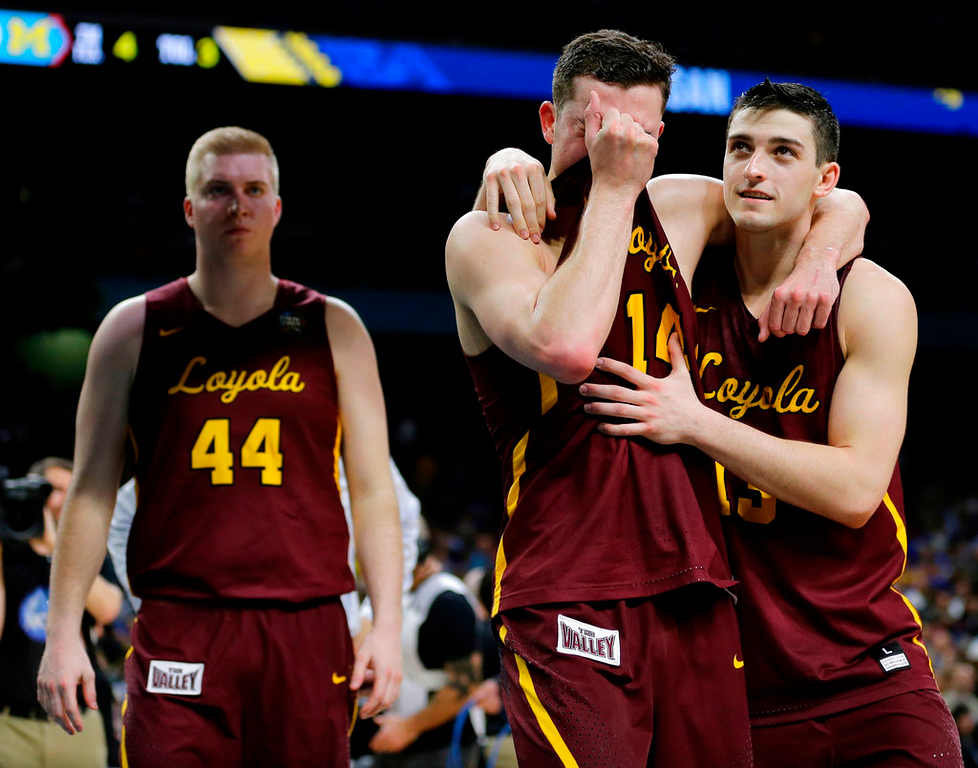 . Loyola-Chicago\'s Ben Richardson embraces with Clayton Custer, right, after the semifinals of the Final Four NCAA college basketball tournament against Michigan, Saturday, March 31, 2018, in San Antonio. Michigan won 69-57. (AP Photo/David J. Phillip)