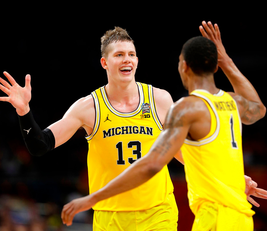 . Michigan\'s Moritz Wagner (13) celebrates with Charles Matthews (1) during the second half in the semifinals of the Final Four NCAA college basketball tournament against Loyola-Chicago, Saturday, March 31, 2018, in San Antonio. (AP Photo/Eric Gay)