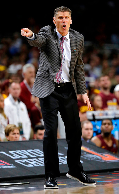 . Loyola-Chicago head coach Porter Moser directs his team during the second half against Michigan in the semifinals of the Final Four NCAA college basketball tournament, Saturday, March 31, 2018, in San Antonio. (AP Photo/David J. Phillip)