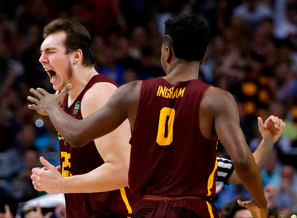 . Loyola-Chicago\'s Cameron Krutwig (25) celebrates a play with Donte Ingram (0) during the second half in the semifinals of the Final Four NCAA college basketball tournament, Saturday, March 31, 2018, in San Antonio. (AP Photo/David J. Phillip)
