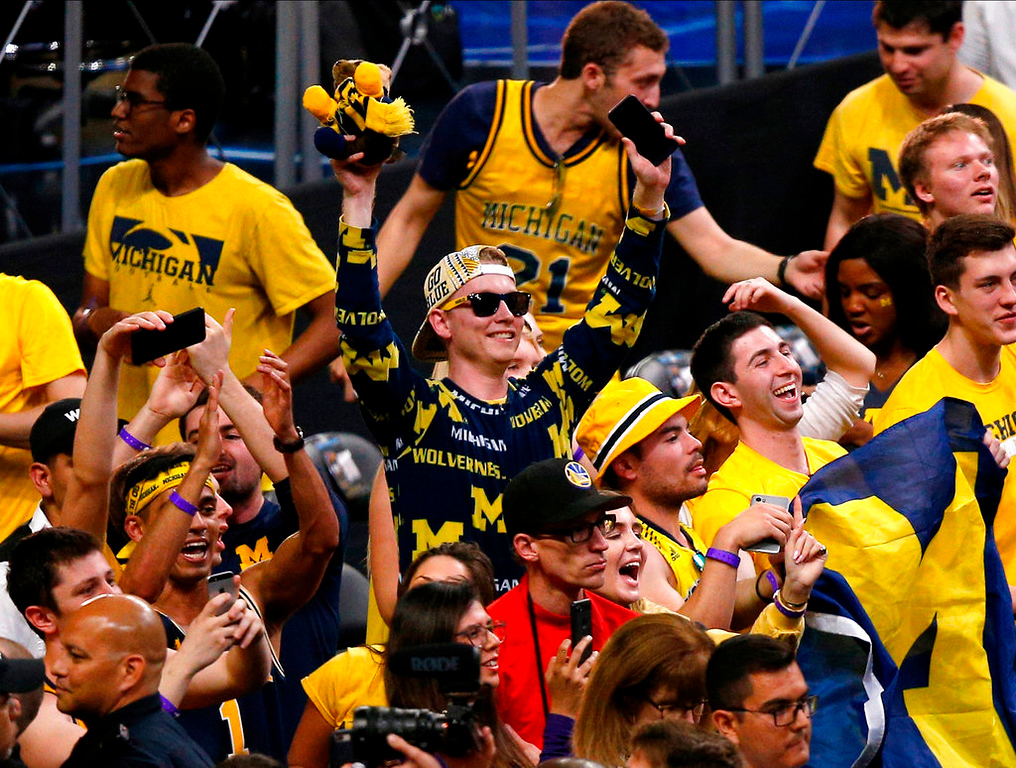 . Michigan fans cheer during the second half against Loyola-Chicago in the semifinals of the Final Four NCAA college basketball tournament, Saturday, March 31, 2018, in San Antonio. Michigan won 69-57. (AP Photo/Brynn Anderson)