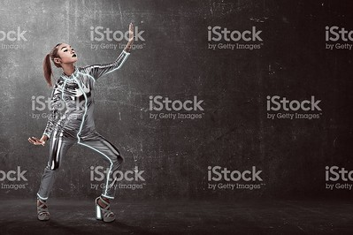 Asian woman wearing latex jumpsuit posing over grunge background