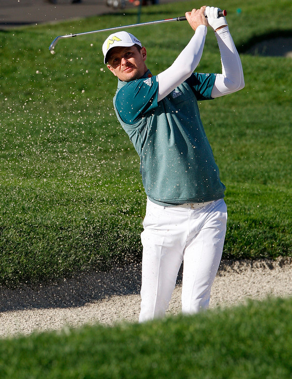 . Justin Rose hits from a bunker on the 2nd hole at the Pebble Beach Golf Links during the Final round of the AT&T Pebble Beach Pro Am on Sunday, Feb. 12, 2017.  (Vern Fisher - Monterey Herald)