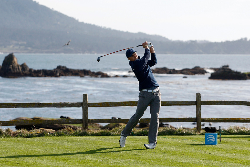 . Jordan Spieth tees off from the 18th hole at the Pebble Beach Golf Links during the Final round of the AT&T Pebble Beach Pro Am on Sunday, Feb. 12, 2017.  Spieth won the tournament by four strokes over Kelly Kraft.  (Vern Fisher - Monterey Herald)