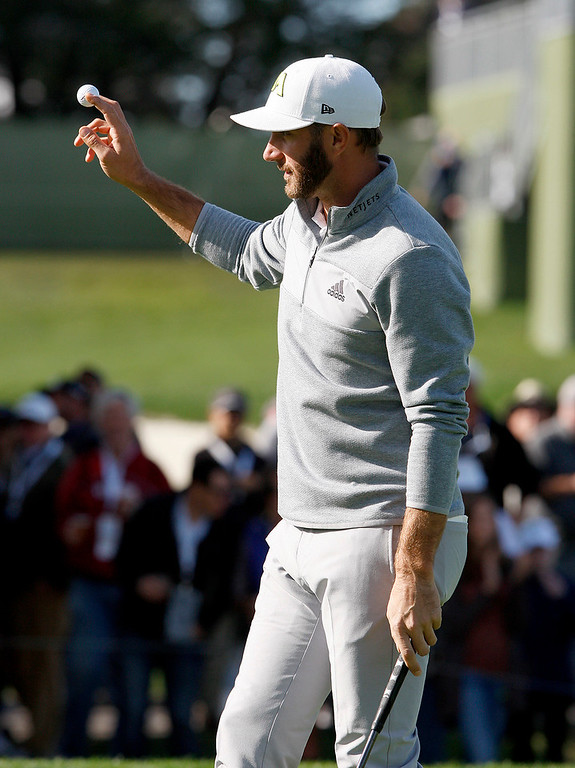 . Dustin Johnson celebrates a birdie putt on the 17th hole at the Pebble Beach Golf Links during the Final round of the AT&T Pebble Beach Pro Am on Sunday, Feb. 12, 2017.  (Vern Fisher - Monterey Herald)