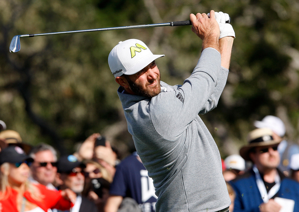 . Dustin Johnson tees off from the 17 hole at the Pebble Beach Golf Links during the Final round of the AT&T Pebble Beach Pro Am on Sunday, Feb. 12, 2017.  (Vern Fisher - Monterey Herald)