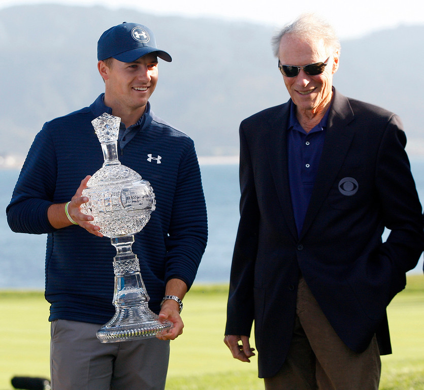 . Jordan Spieth hold his crystal trophy next to Clint Eastwood on the 18th hole at the Pebble Beach Golf Links during the Final round of the AT&T Pebble Beach Pro Am on Sunday, Feb. 12, 2017.  (Vern Fisher - Monterey Herald)