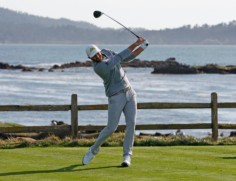 . Dustin Johnson tees off from the 18th hole at the Pebble Beach Golf Links during the Final round of the AT&T Pebble Beach Pro Am on Sunday, Feb. 12, 2017.  (Vern Fisher - Monterey Herald)
