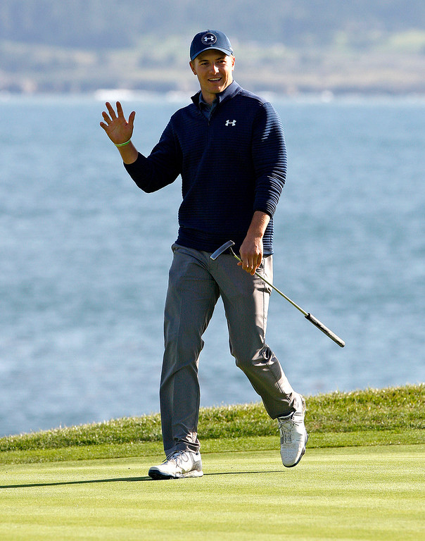 . Jordan Spieth acknowledges the crowd as he walks up the 18th green at the Pebble Beach Golf Links during the Final round of the AT&T Pebble Beach Pro Am on Sunday, Feb. 12, 2017.  (Vern Fisher - Monterey Herald)