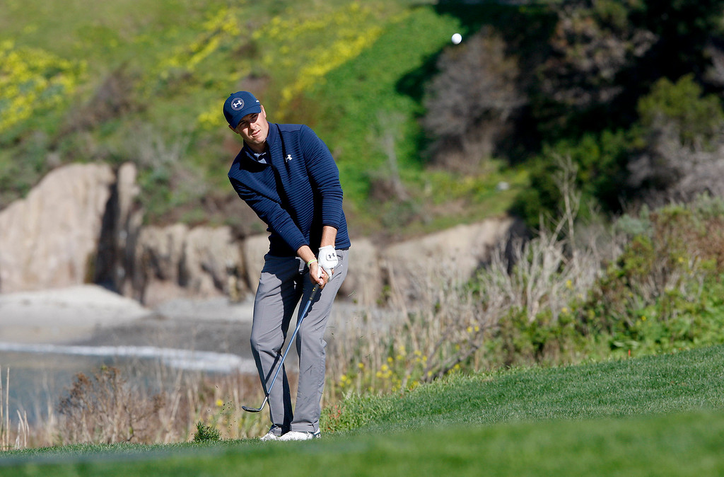. Jordan Spieth chips on to the 6th hole at the Pebble Beach Golf Links during the Final round of the AT&T Pebble Beach Pro Am on Sunday, Feb. 12, 2017.  Spieth wins the tournament by four strokes over Kelly Kraft.  (Vern Fisher - Monterey Herald)
