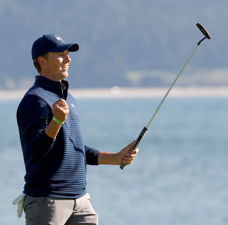 . Jordan Spieth celebrates his win on the 18th green at the Pebble Beach Golf Links during the Final round of the AT&T Pebble Beach Pro Am on Sunday, Feb. 12, 2017.  (Vern Fisher - Monterey Herald)