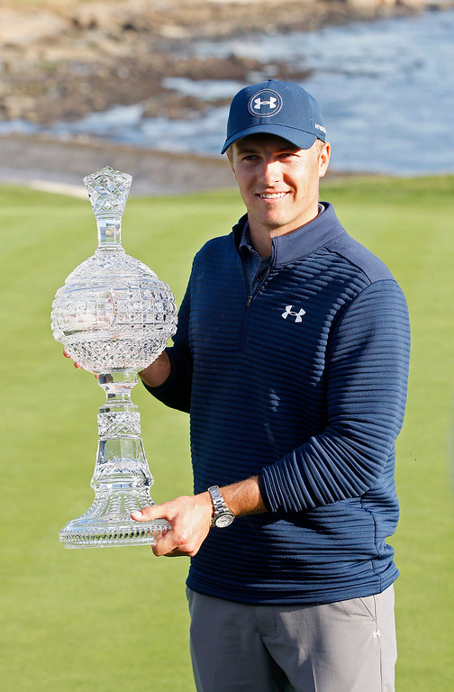 . Jordan Spieth holds the crystal trophy on the 18th green at the Pebble Beach Golf Links during the Final round of the AT&T Pebble Beach Pro Am on Sunday, Feb. 12, 2017.  (Vern Fisher - Monterey Herald)