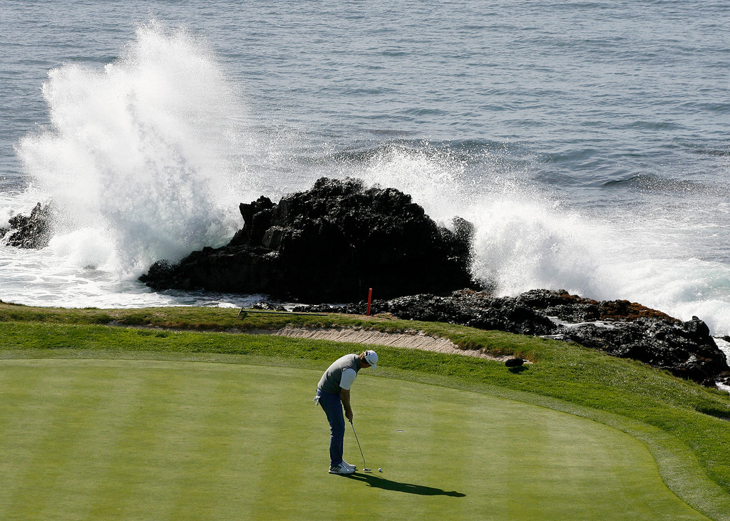 . Brandt Snedeker putts on the 7th hole at the Pebble Beach Golf Links during the Final round of the AT&T Pebble Beach Pro Am on Sunday, Feb. 12, 2017.  (Vern Fisher - Monterey Herald)