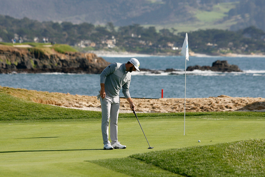 . Dustin Johnson lines up a putt on the 17th hole at the Pebble Beach Golf Links during the Final round of the AT&T Pebble Beach Pro Am on Sunday, Feb. 12, 2017.  (Vern Fisher - Monterey Herald)