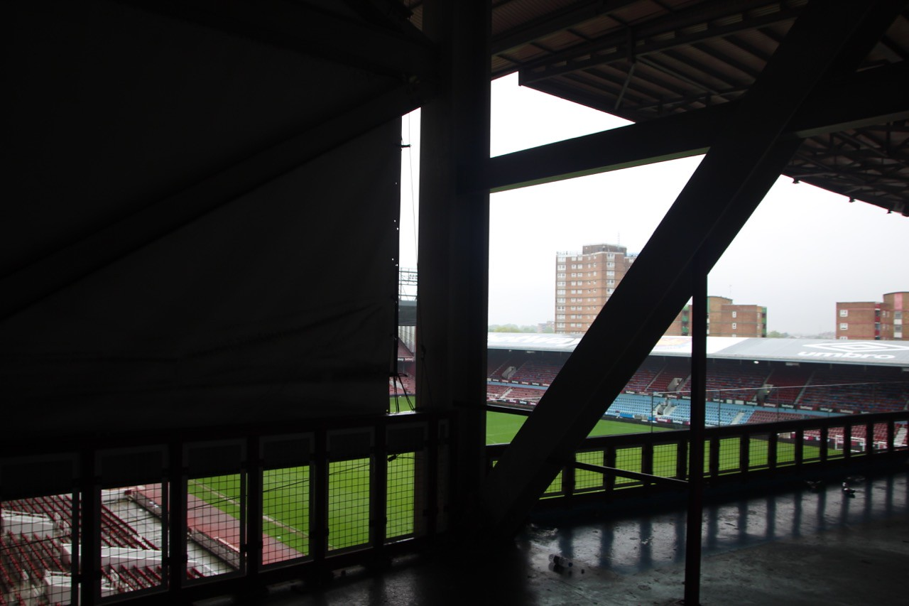 Climbing open metal staircase up to roof of Bobby Moore Stands.