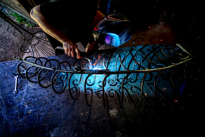 KRISTOPHER RADDER - BRATTLEBORO REFORMER<br /> Rich Gillis, of Mystic Metallurgy, puts the final touches on the spine of a mermaid on Monday, June 12, 2017, that he has been working on throughout the past year. The mermaid is currently on display at the Welcome Center.