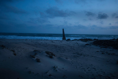 The pillar in memories of cyclone victims by the Indian Ocean