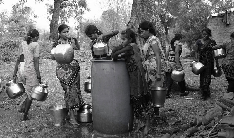 Women filling water from the drum which comes on the weekly basis in Vai village, Vidarbha