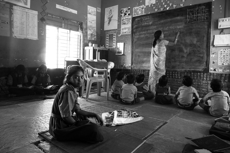 School in Jwada village, where Roshni and Tanu studies. The girl in the centre is mentally ill and has been seated separately.