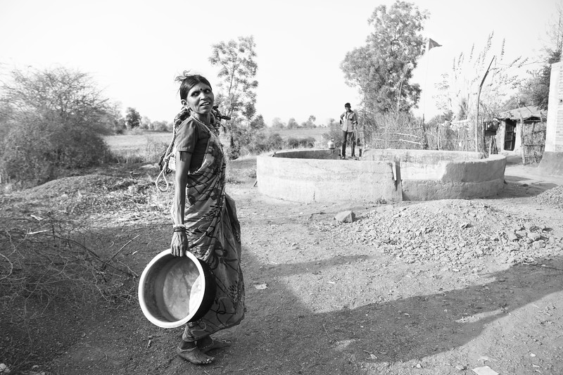 The woman and his son filling up unclean water from the well after no supply of tap water for a week in Buldhana district