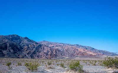 The Panament, above, and Amargosa Mountains form the valley, each running north to south.