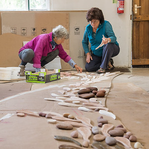 Lesley and Maria-Laura arranging the baked mosaic parts