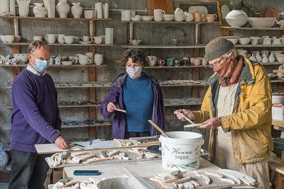 Ongoing work in Findhorn Park Pottery, with covid masks because of stricter Scottish rules