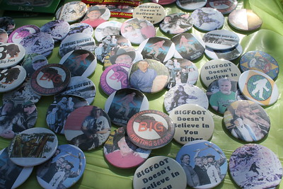 Buttons adorn Jerry Hein's booth at the Finding Bigfoot Festival in Willow Creek.  (Natalya Estrada - The Times-Standard)