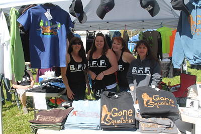 Jessica Swain, Christine Wade, Susan Martin and Sandy Bradford sell 'Gone Squatchin' T-shirts at the Finding Bigfoot Festival in Willow Creek. (Natalya Estrada - The Times-Standard)