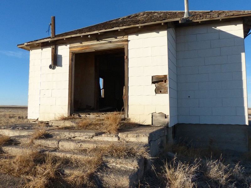 A not uncommon sight out on the plains. This was a meeting hall of some kind back in the day.