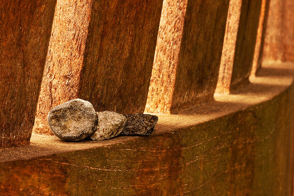Park bench with tiny pebbles