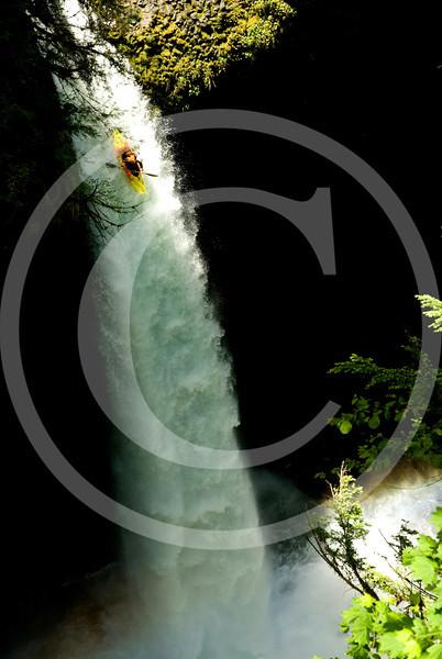 Kayaker running Metlako Falls - Oregon - Copyright 2010 - Charlie Munsey