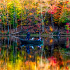 Brilliant colors surrounding fishing boat in the on a lake