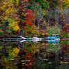 Pontoon boat on the water in Fall
