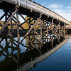 Rail trail bridge reflections in the water